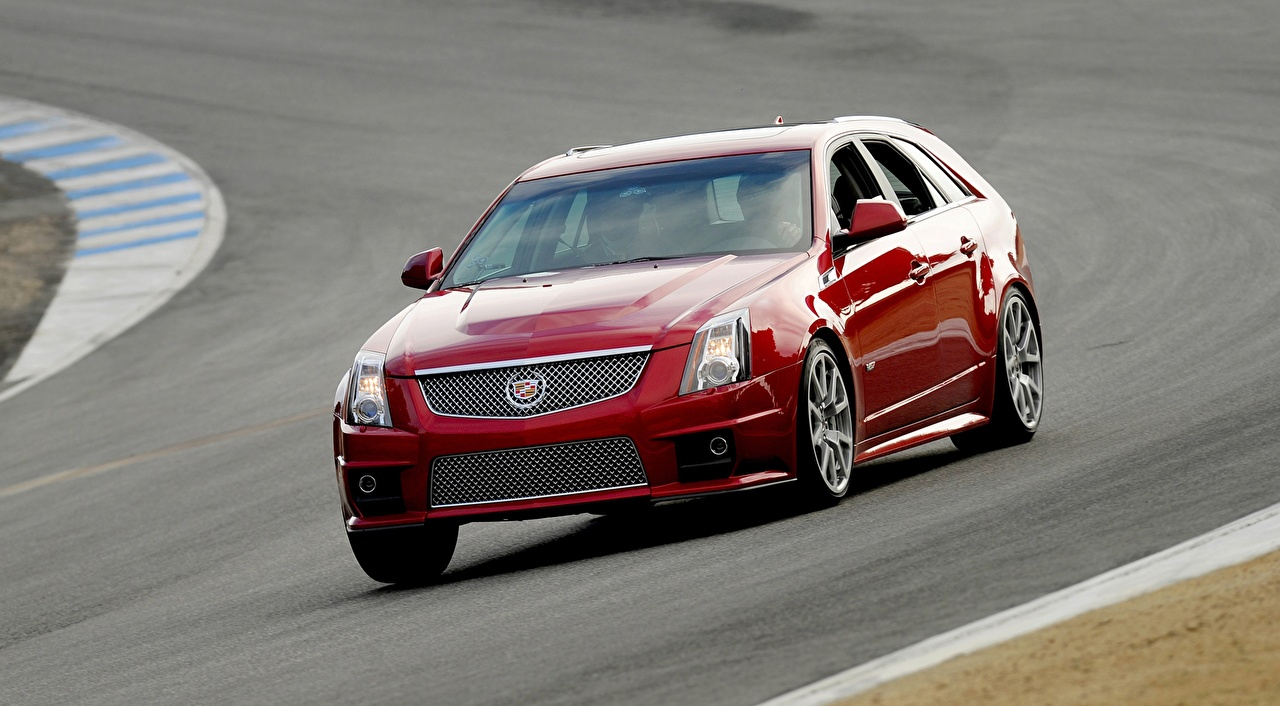 Images Cadillac Station wagon CTS-V, Sport Wagon Red driving auto Metallic Estate car Motion riding moving at speed Cars automobile