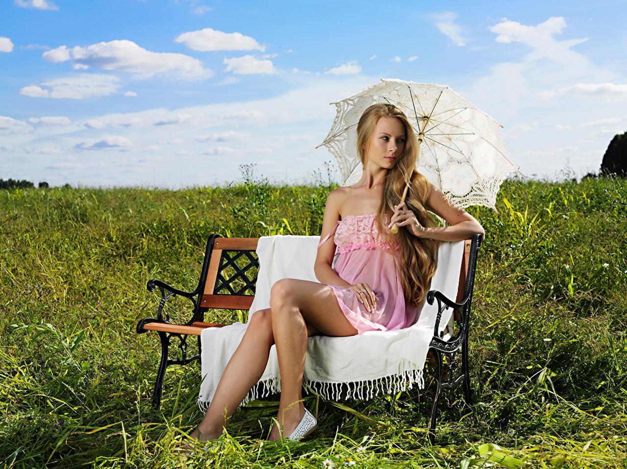 Photos Blonde girl Girls Summer Legs Grass Bench Sitting Umbrella female young woman sit parasol