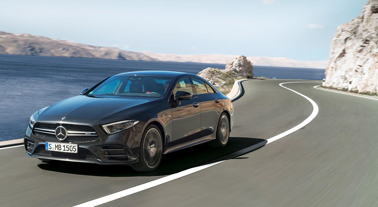 Fotos Mercedes-Benz AMG, CLS, 53 4MATIC, 2018 Limousine Schwarz fährt Straße auto Wege fahren Bewegung fahrendes Geschwindigkeit Autos automobil