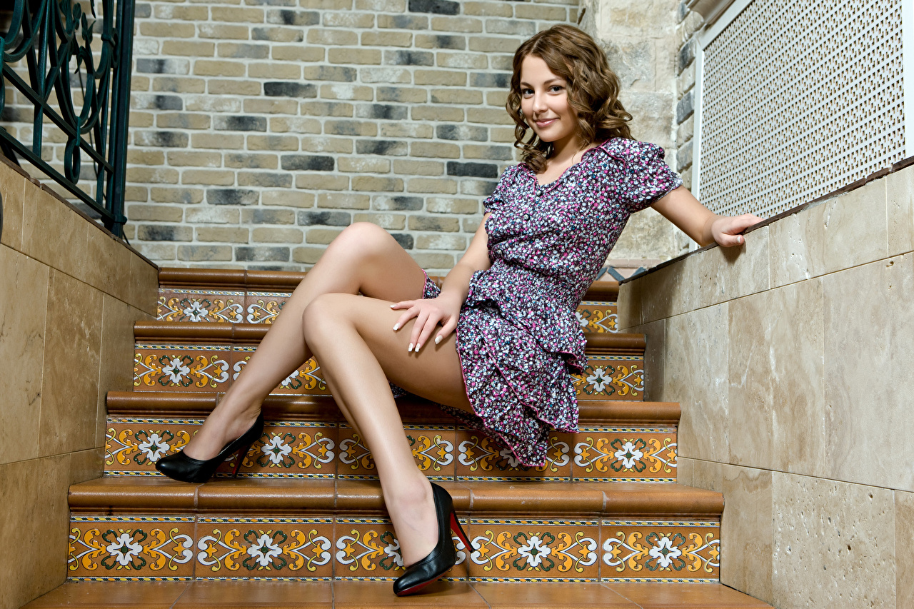 Image Brown haired Girls Stairs Legs Hands Sitting Dress Stilettos female stairway staircase young woman sit gown frock high heels