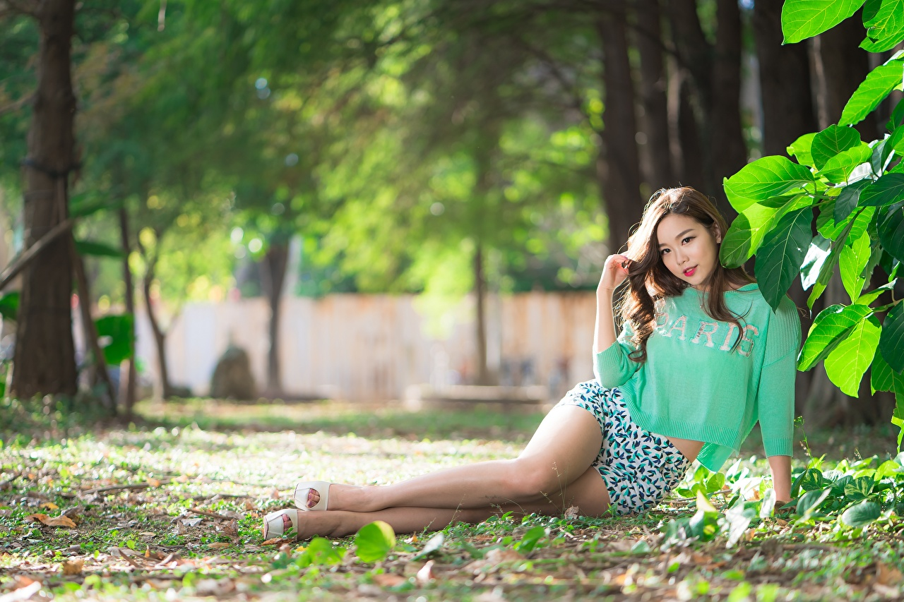 Picture Foliage Brown haired Bokeh Beautiful young woman Legs Asiatic Shorts Leaf blurred background Girls female Asian