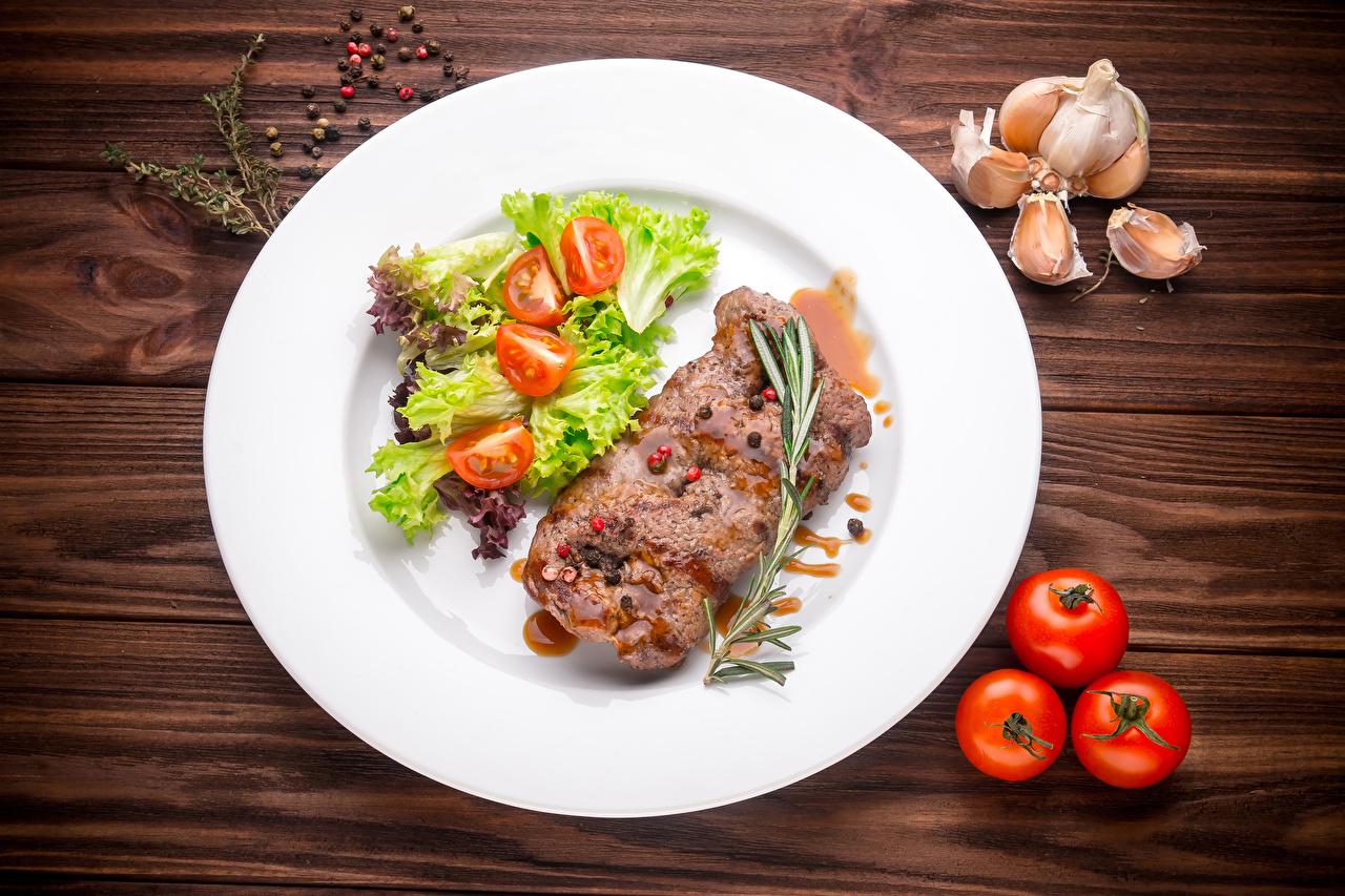 Bilder Tomate Knoblauch Teller Gemüse Lebensmittel Fleischwaren