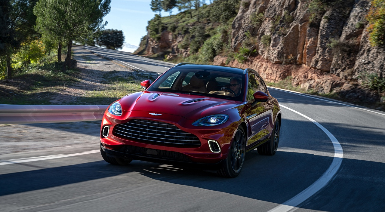 Picture Aston Martin CUV DBX, 2020 Red Roads Motion Front automobile Crossover moving riding driving at speed Cars auto