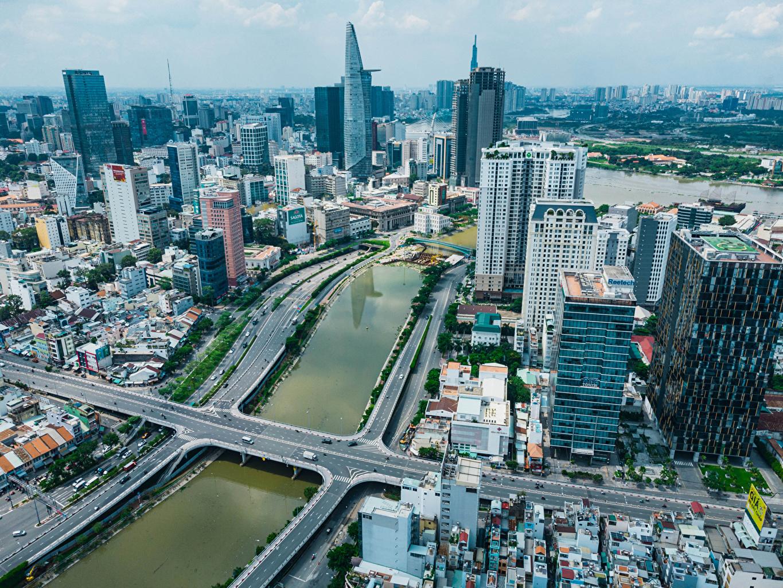 Achtergronden Vietnam Ho Chi Minh City brug rivier Bovenaanzicht Huizen Steden Bruggen Rivieren van bovenaf gebouw gebouwen een stad