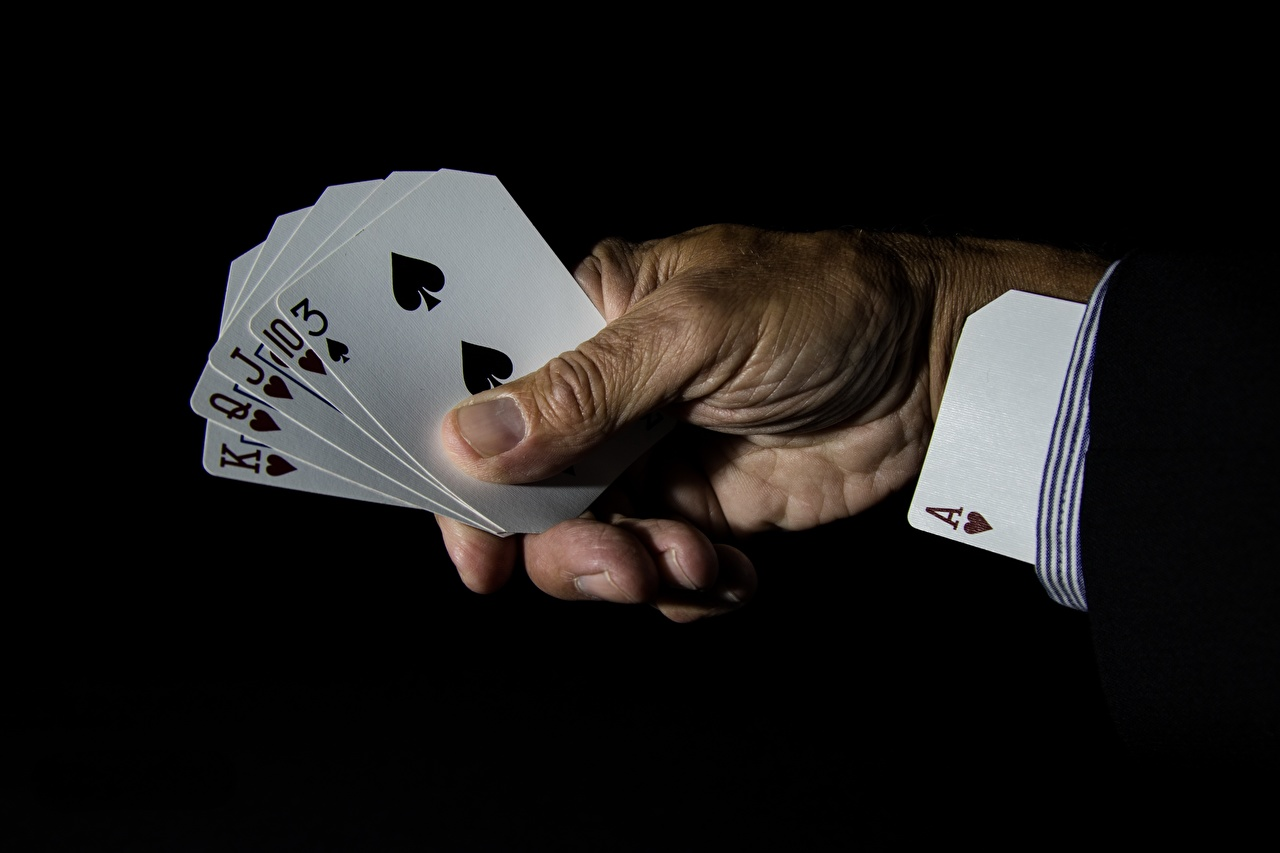 Photo Ace Cards Hands Black background playing cards