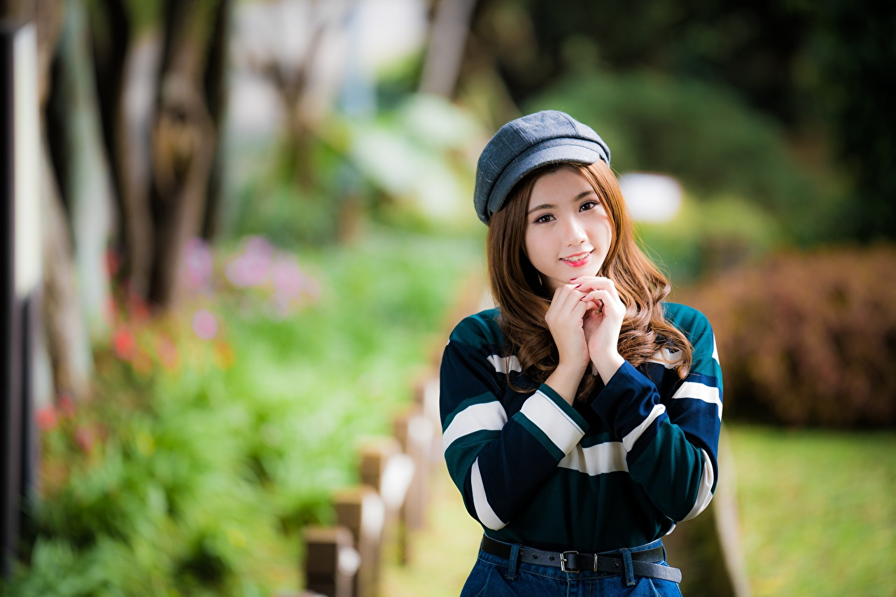 Photo Brown haired Smile Bokeh lovely young woman Asiatic Hands Staring Baseball cap blurred background Cute sweet pretty Girls female Asian Glance
