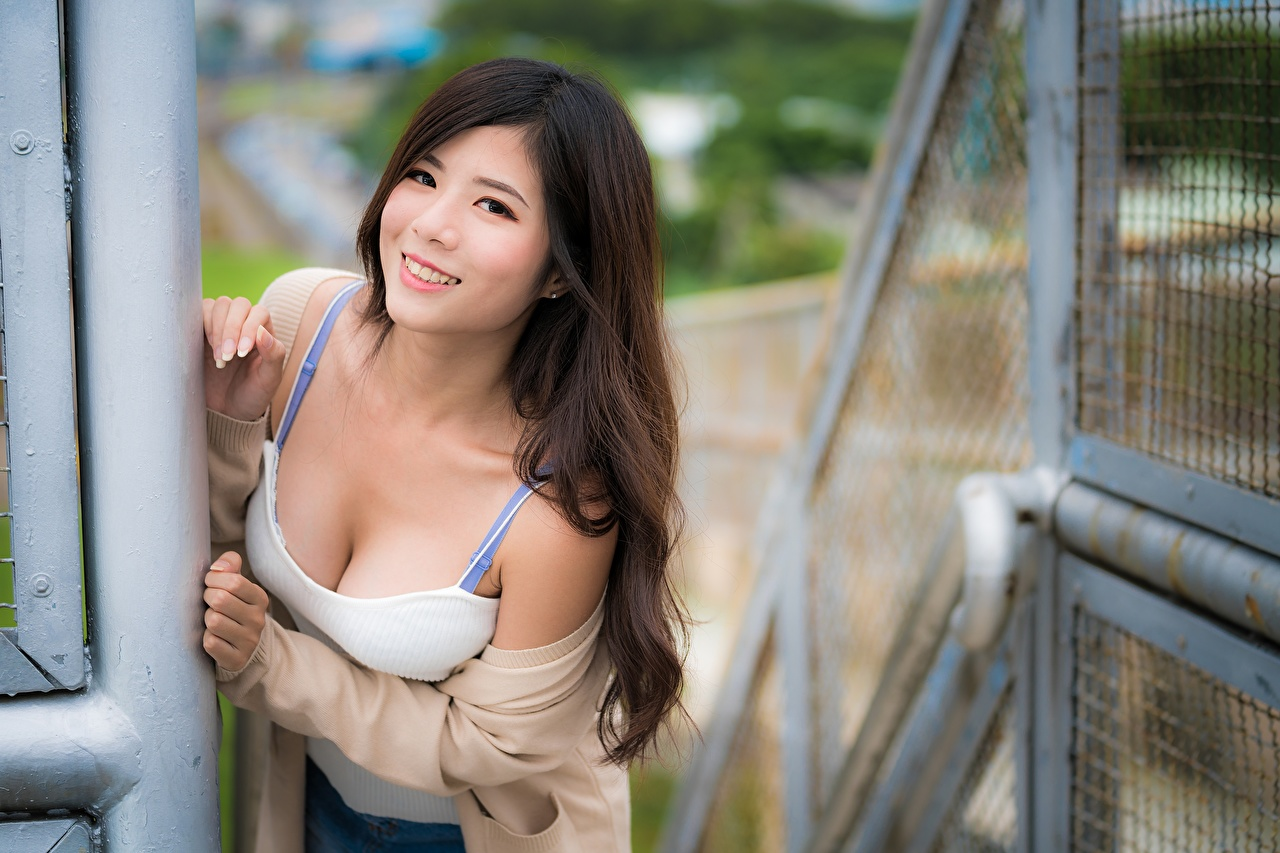 Photo Brown haired Smile Bokeh Girls Asiatic Staring blurred background female young woman Asian Glance