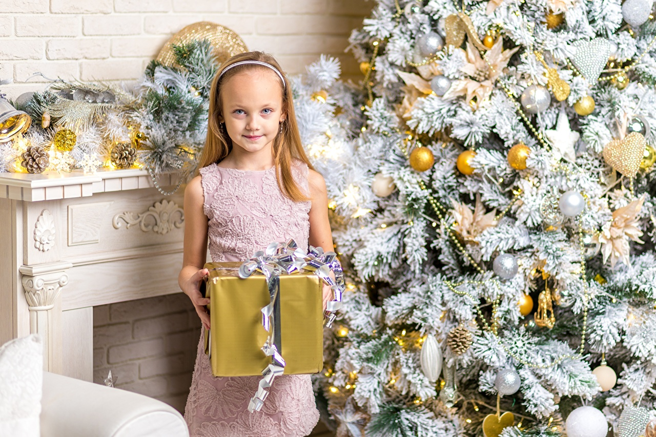 Pictures Little girls New year child New Year tree Gifts Holidays Christmas Children Christmas tree present