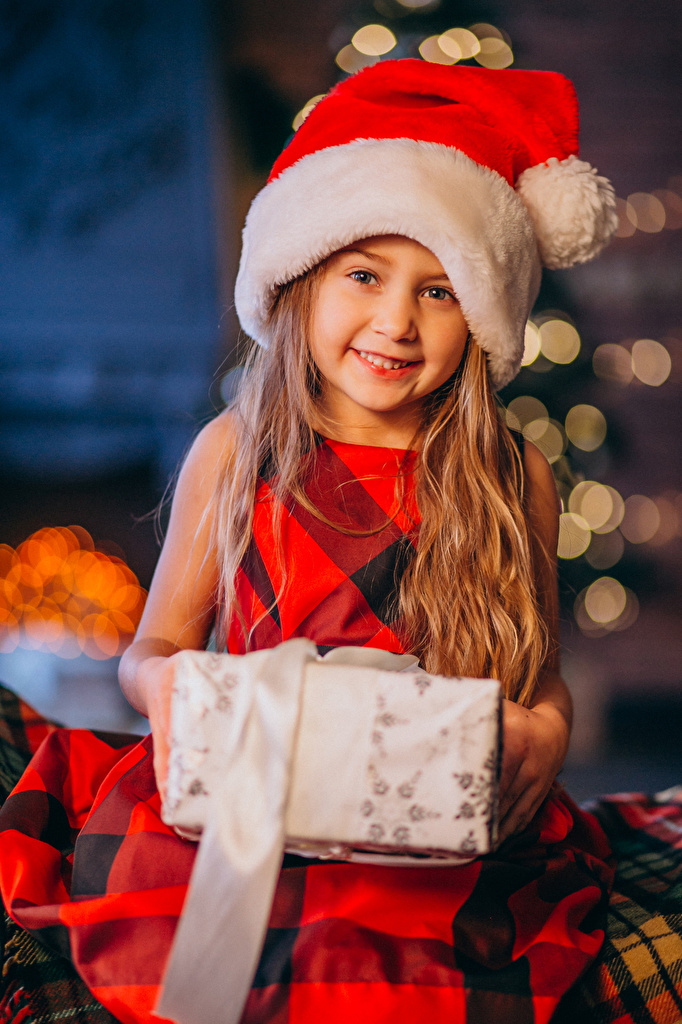Image Little girls New year Smile child Winter hat present Glance  for Mobile phone Christmas Children Gifts Staring