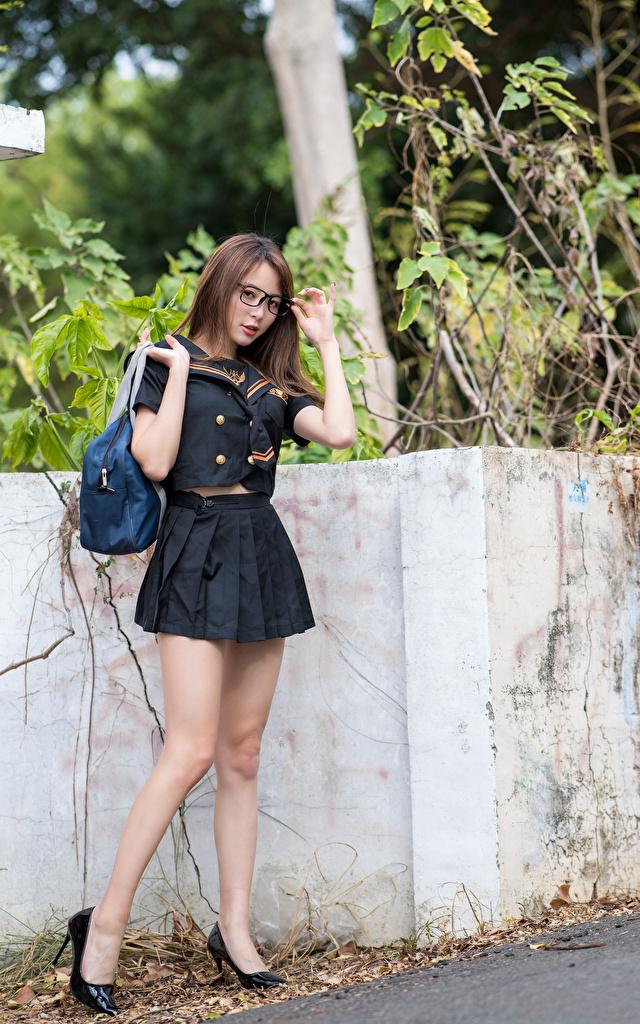 Photos posing Girls Legs Asiatic purse Uniform Glasses Stilettos  for Mobile phone Pose female young woman Asian Handbag eyeglasses high heels