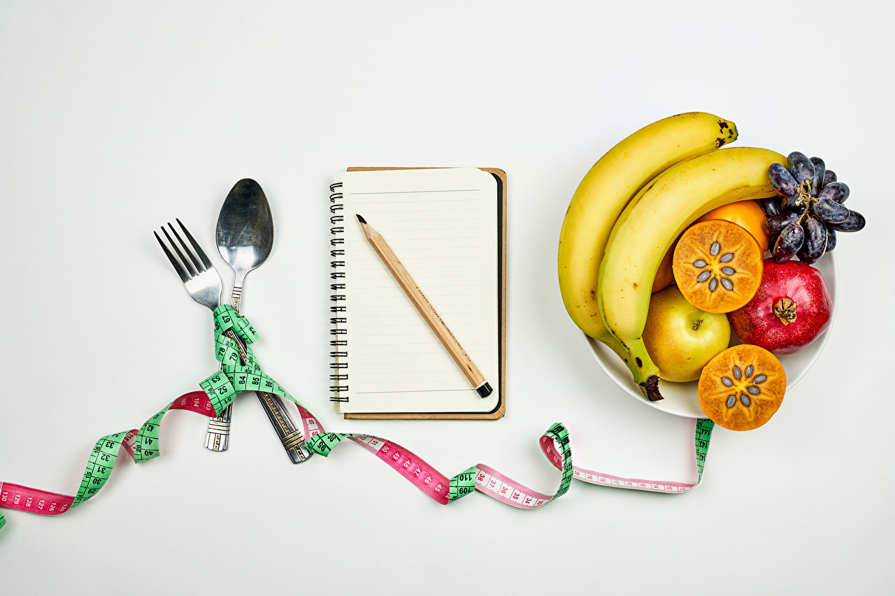 Wallpaper pencil Notepad Healthy eating Tape measure Grapes Apples Bananas Pomegranate Food Fruit Spoon Gray background Pencils