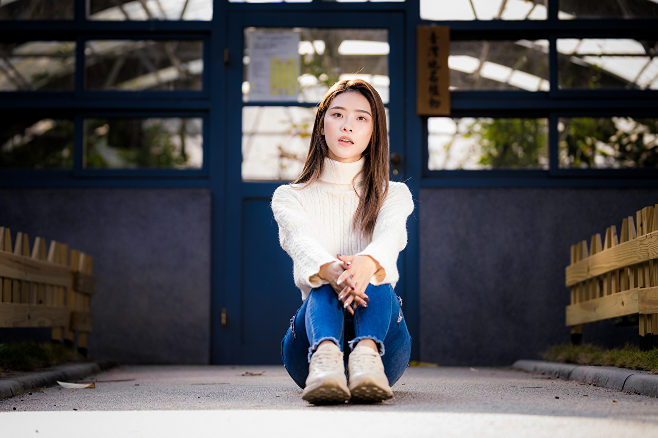 Photos Girls Jeans Asiatic Sweater sit Glance female young woman Asian Sitting Staring