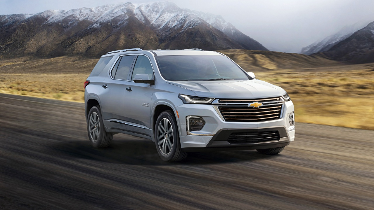 Photos Chevrolet CUV Traverse, 2021 Silver color moving auto Metallic Crossover Motion riding driving at speed Cars automobile