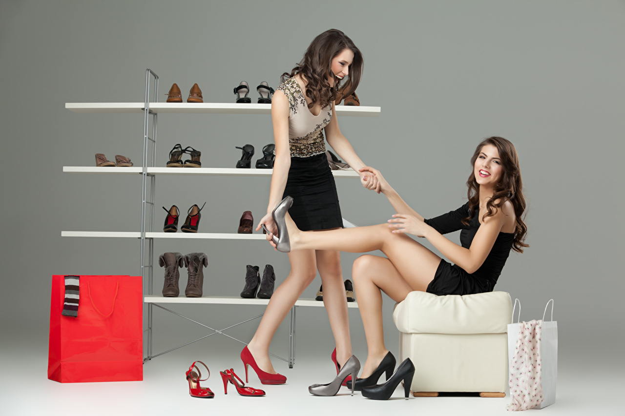 Images Brown haired Smile Two Girls Legs Hands Sitting frock Stilettos 2 female young woman sit gown Dress high heels