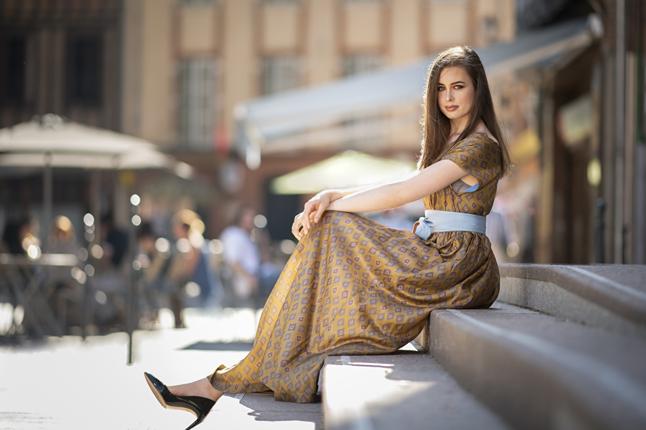 Photos Brown haired Modelling blurred background Girls staircase young woman Sitting Dress high heels Model Bokeh Girls Stairs female stairway sit gown frock Stilettos