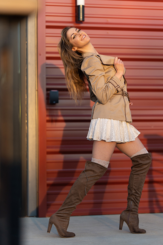 Picture Korbi Kay Wearing boots posing Jacket female Legs Glance  for Mobile phone Pose Girls young woman Staring