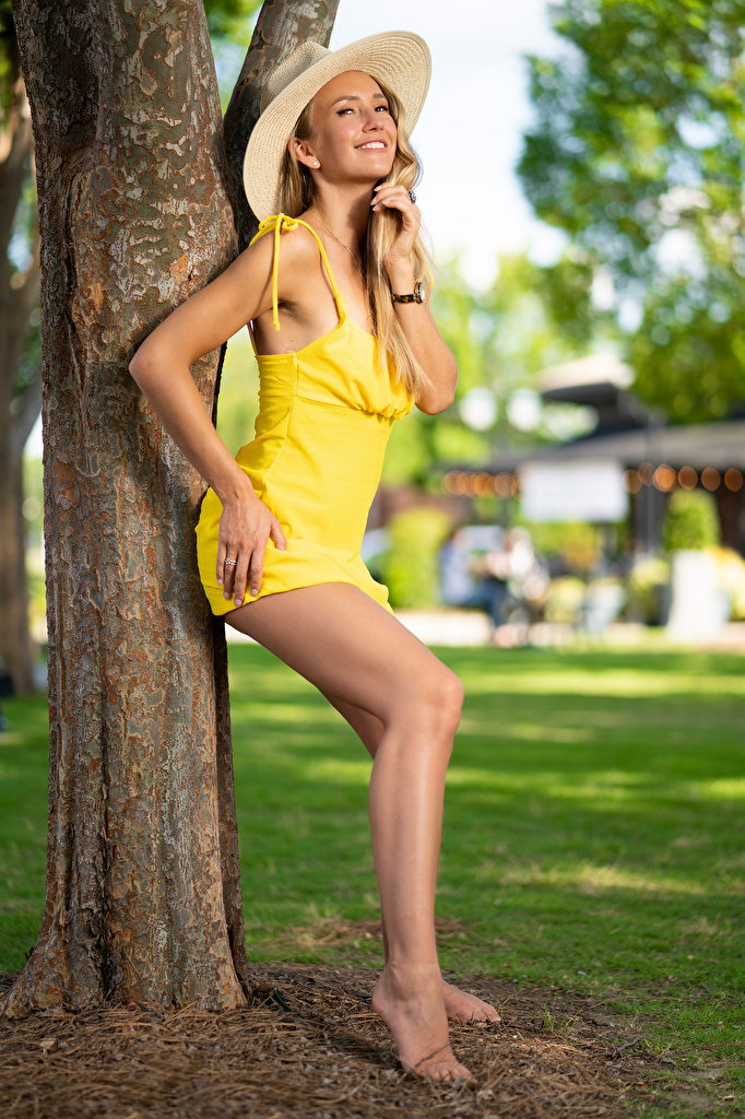 Image young woman Legs Olga Clevenger gown Trunk tree Hat Smile posing  for Mobile phone Girls female frock Dress Pose