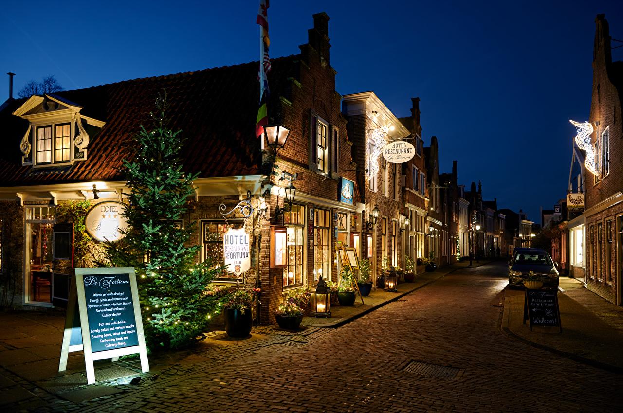 Wallpaper New year Netherlands Edam Street Evening Street lights Houses Cities Christmas Building