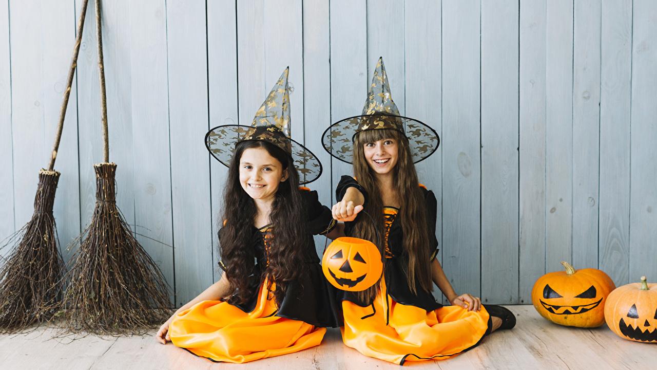Picture Little girls Smile Children Two Hat Pumpkin Halloween sit walls Hands Uniform child 2 Wall Sitting