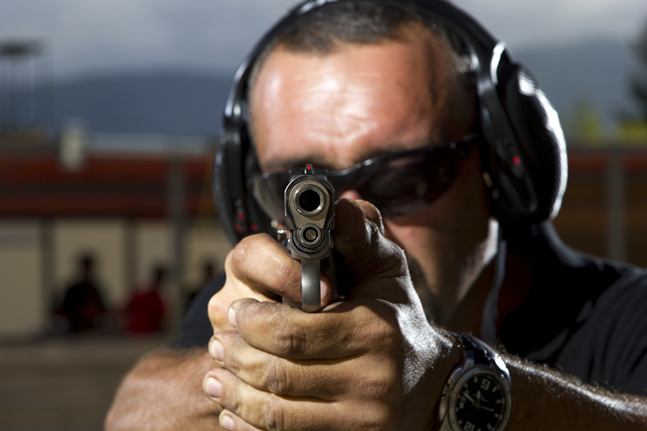 Picture military Pistols Men hearing protection safety goggles technical Hands Closeup Gun barrel Army pistol Man