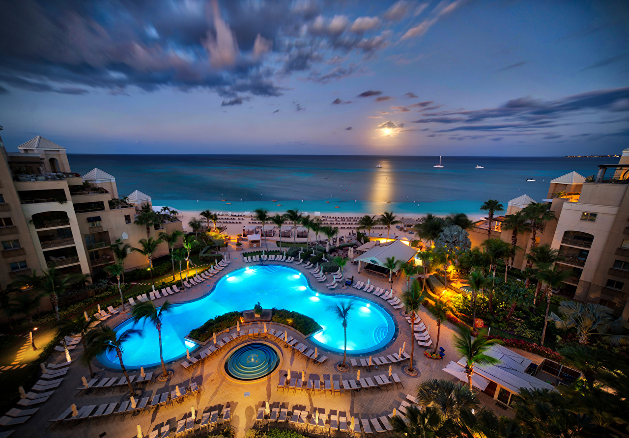 Image Pools Resorts Carribean Grand Cayman Hotel Palms Tropics Evening Cities Building Spa town Swimming bath palm trees Houses