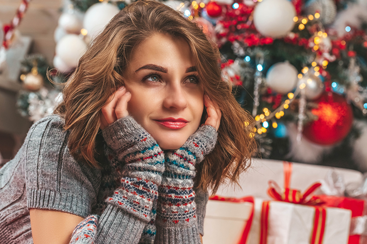 Images New year Brown haired Girls Hands Staring Christmas female young woman Glance