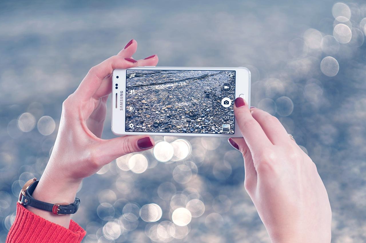 Fotos von Maniküre Smartphone Hand Finger
