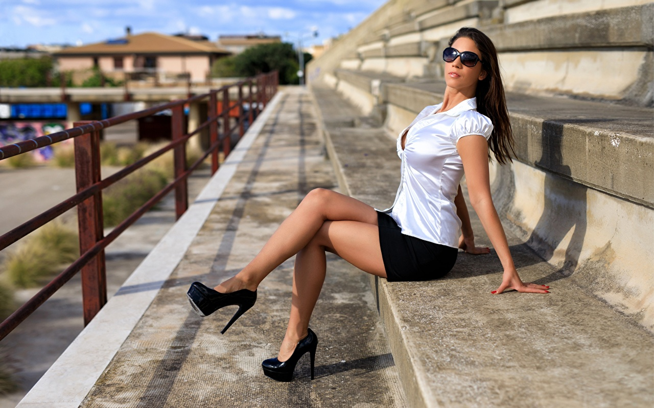 Photos Brown haired young woman Legs Glasses Sitting high heels Girls female sit eyeglasses Stilettos