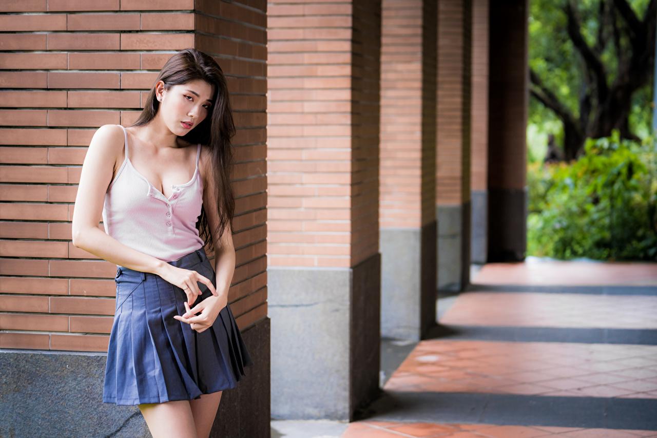 Image Skirt Bokeh Pose female Asian Sleeveless shirt Glance blurred background posing Girls young woman Asiatic Singlet Staring