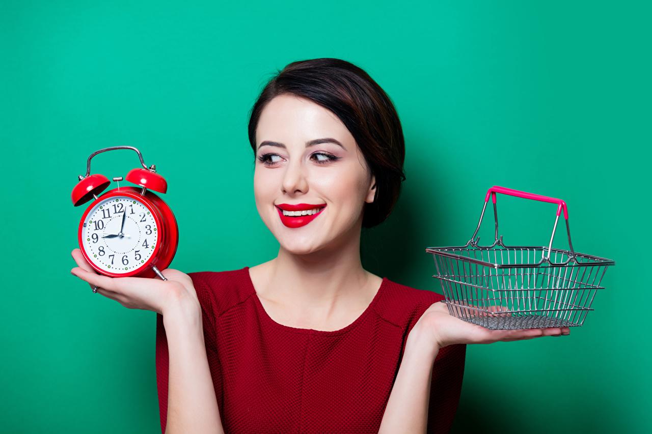 Wallpaper Brunette girl Smile Girls Clock Alarm clock Wicker basket Hands Red lips Colored background