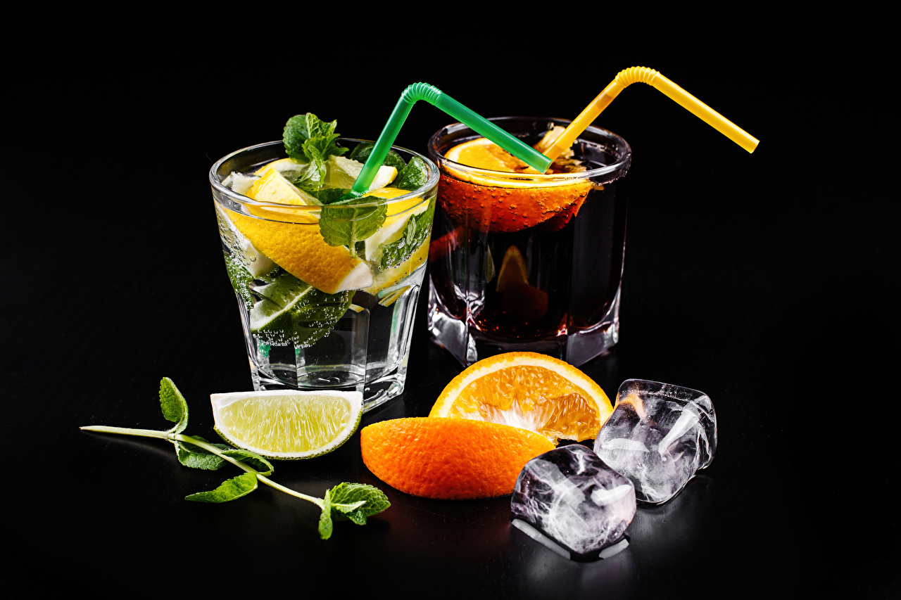 Photos Alcoholic drink Ice Two Mojito Orange fruit Lemons Highball glass Food Mixed drink Black background 2 Cocktail