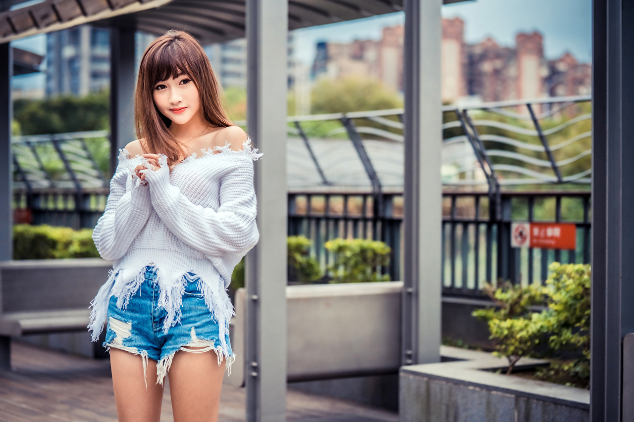 Images blurred background young woman Asiatic Sweater Shorts Staring Bokeh Girls female Asian Glance