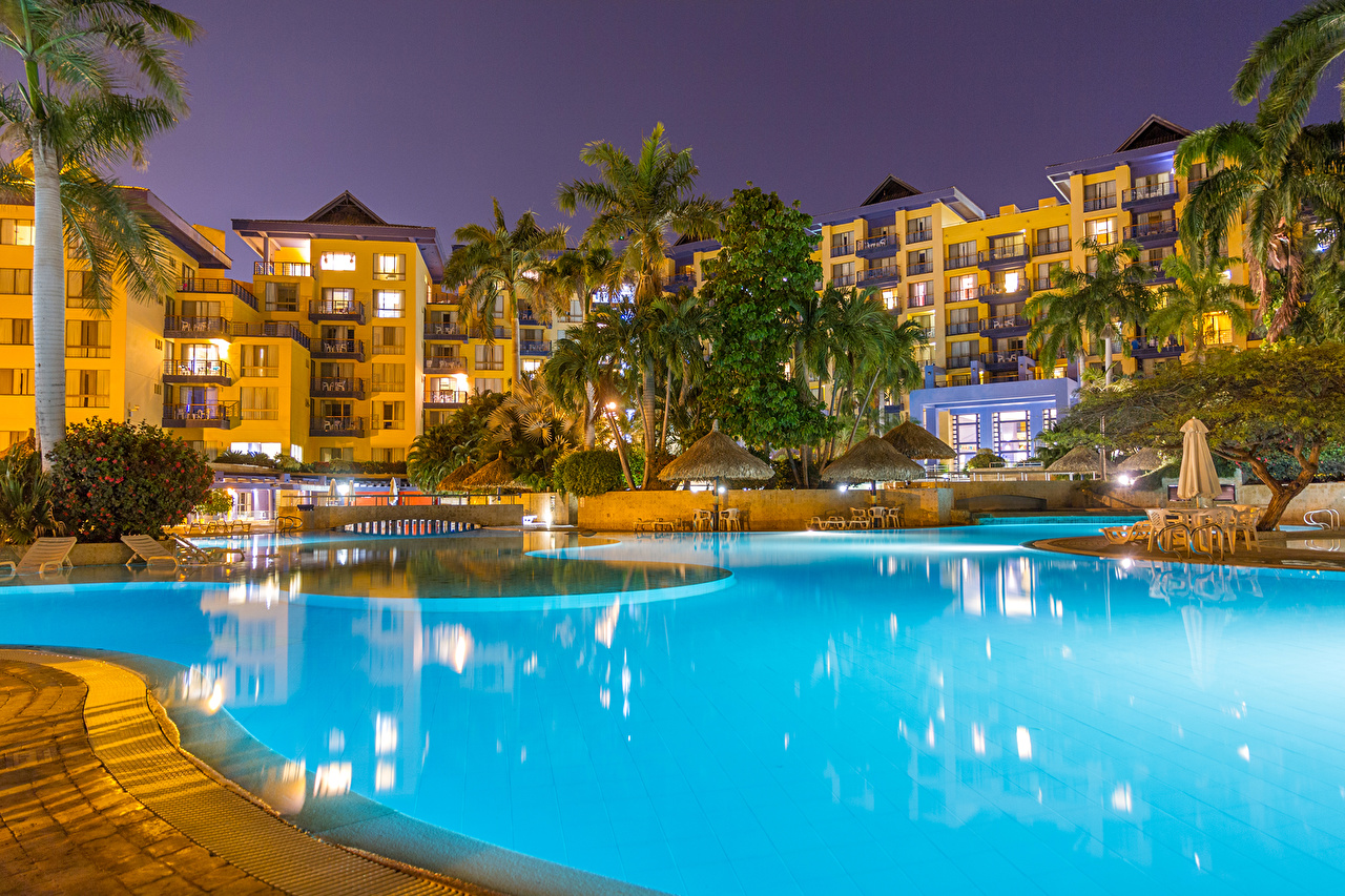 Photo Colombia Spa town Swimming bath Santa Marta Palms Evening Trees Houses Cities Pools Resorts palm trees Building