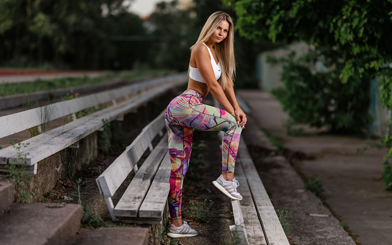 Photo Blonde girl Fitness sneakers young woman Legs Side Bench Hands Uniform Girls female trainers Athletic shoe