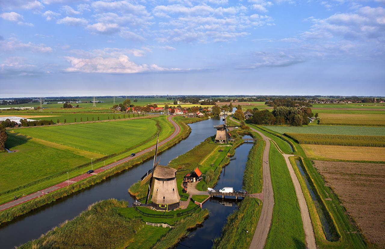 Picture Netherlands Mill Rustenburg Nature Bridges Roads Fields river Houses windmill windmills bridge Rivers Building