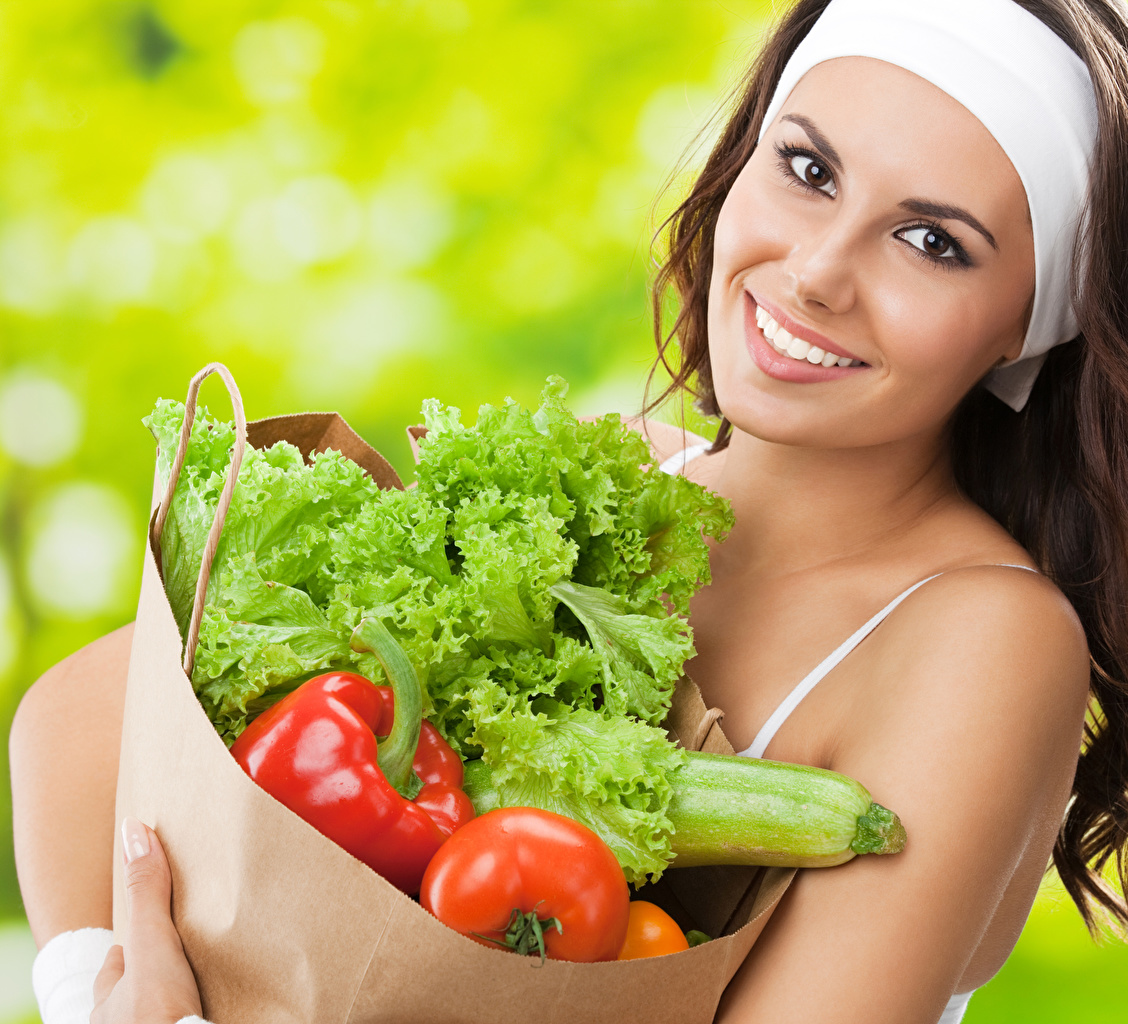 Pictures Brown haired Smile young woman Vegetables Staring Girls female Glance