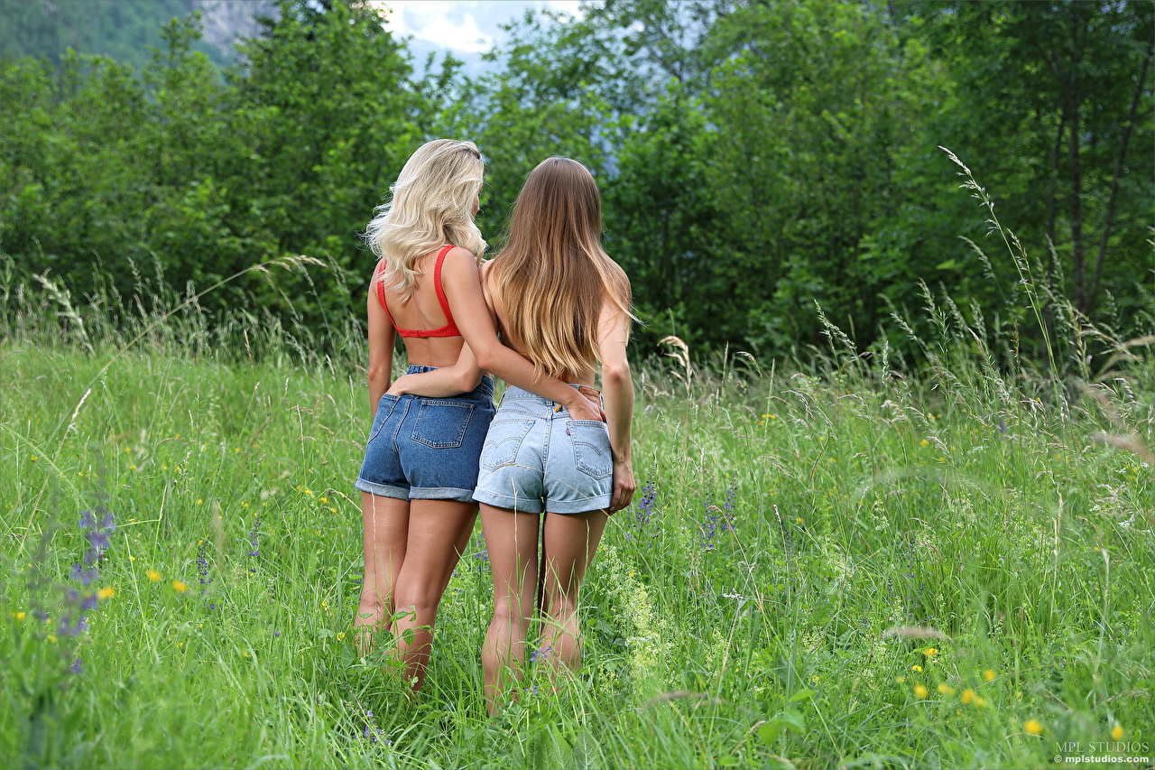 Images Cara Mell Ass buttocks Stefani Two hugs female Grass Shorts Back view 2 Hug Girls hugging embrace young woman