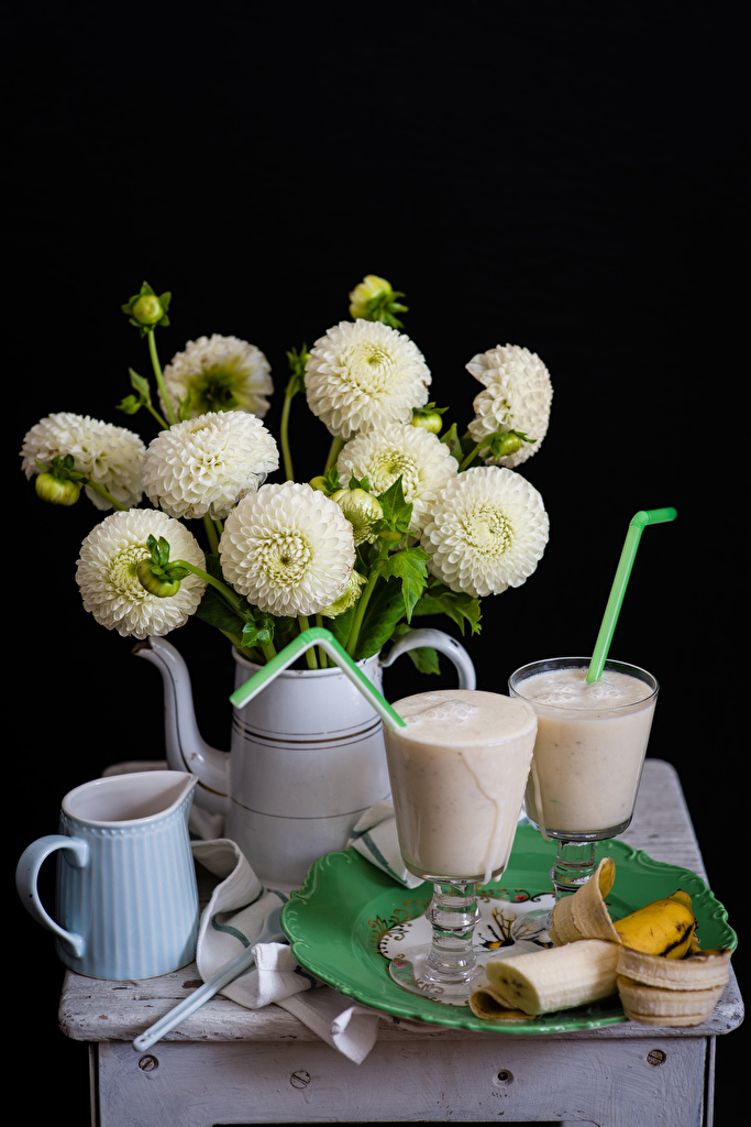 Photo White jugs Dahlias Bananas Flowers Highball glass Food Cocktail Still-life Black background  for Mobile phone flower pitcher Jug container Mixed drink