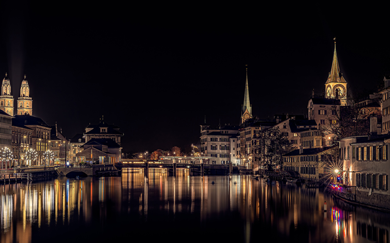 Wallpaper Rays of light Zurich Switzerland bridge Night Rivers Fairy lights Cities Building Bridges river night time Houses