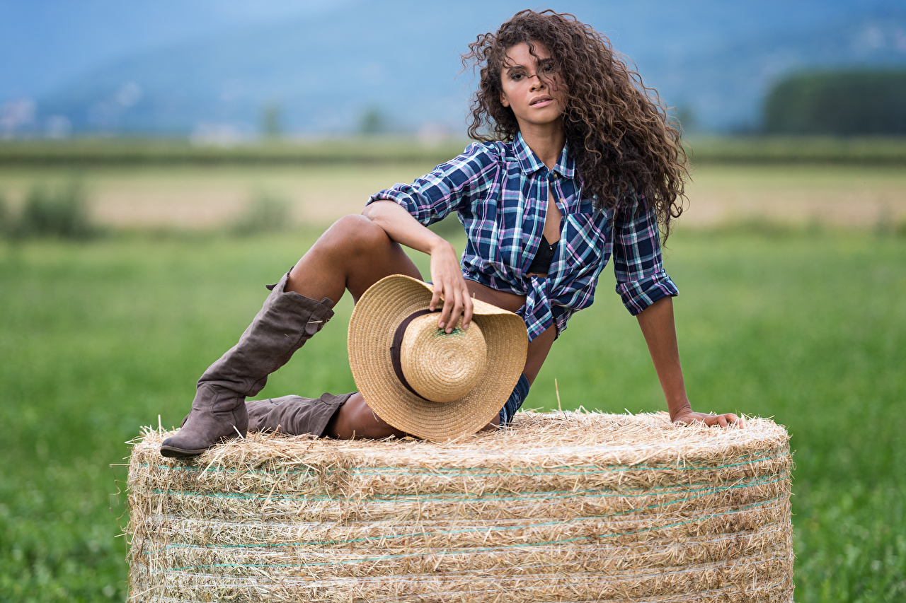 Photo Cowboy Wearing boots Thasia curls Hat Girls Formal shirt Legs Hay Glance Curly female young woman Staring