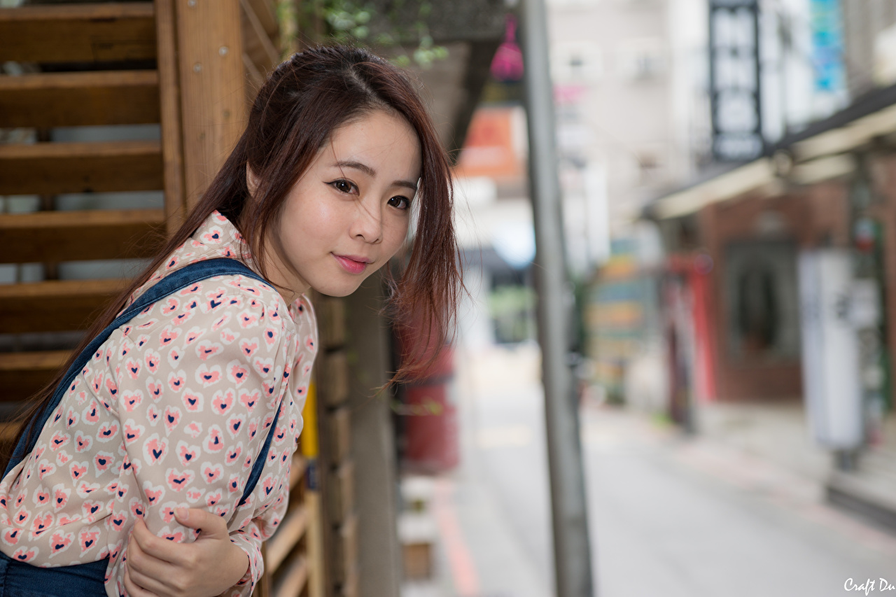 Picture Brown haired Bokeh young woman Asian Hands Glance blurred background Girls female Asiatic Staring