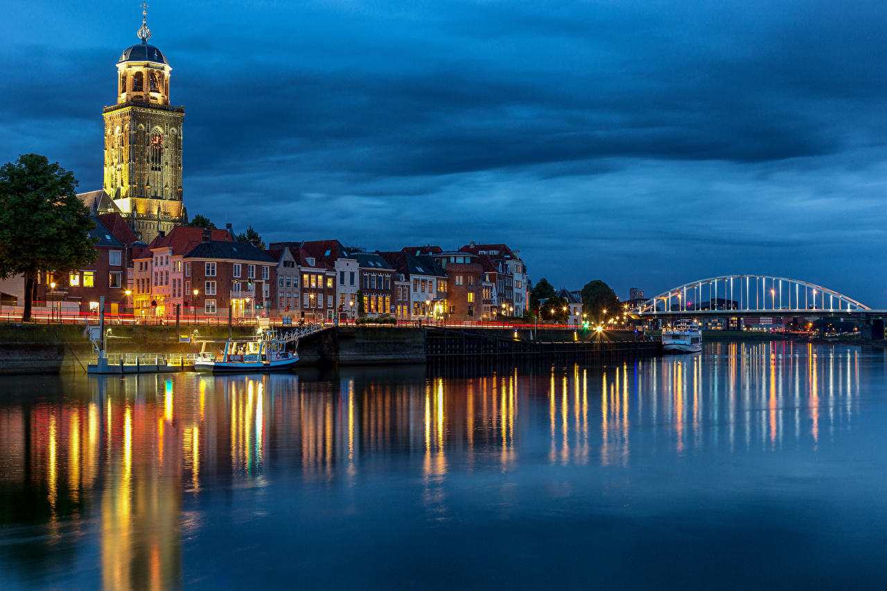 Picture Netherlands Tower Deventer Bridges Riverboat river Evening Cities Building towers bridge Rivers Houses