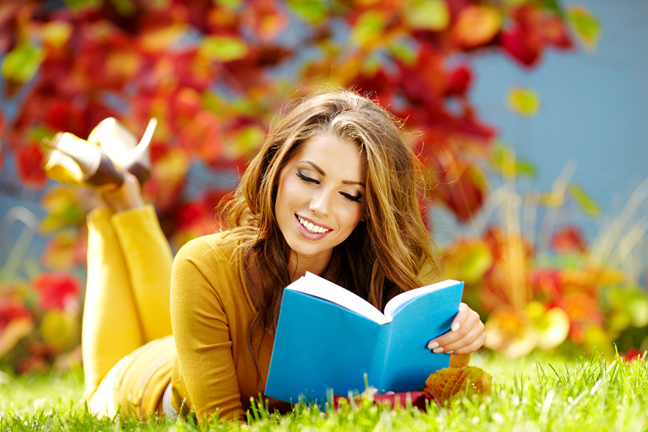 Images Izabela Magier Brown haired Smile laying Autumn female Book Grass esting Lying down Girls young woman books