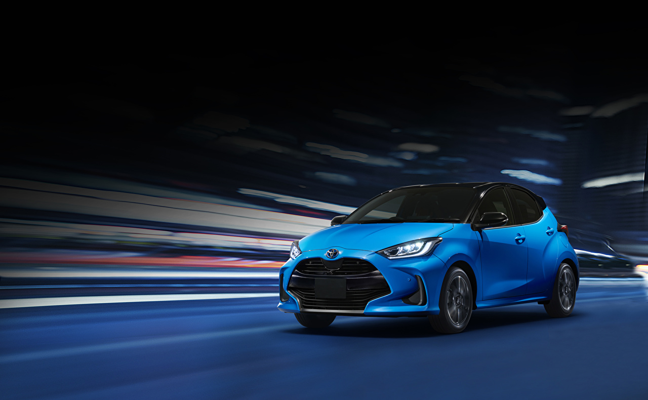 Images Toyota 2020 Yaris Hybrid Light Blue Motion auto moving riding driving at speed Cars automobile