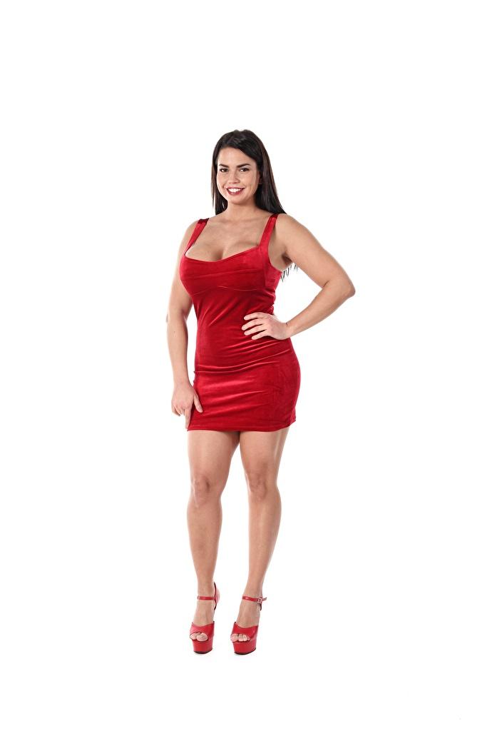 Bilder Chloe Lamour Brünette Lächeln posiert Rot Mädchens Bein Hand Weißer hintergrund Kleid Stöckelschuh  für Handy Pose junge frau junge Frauen High Heels