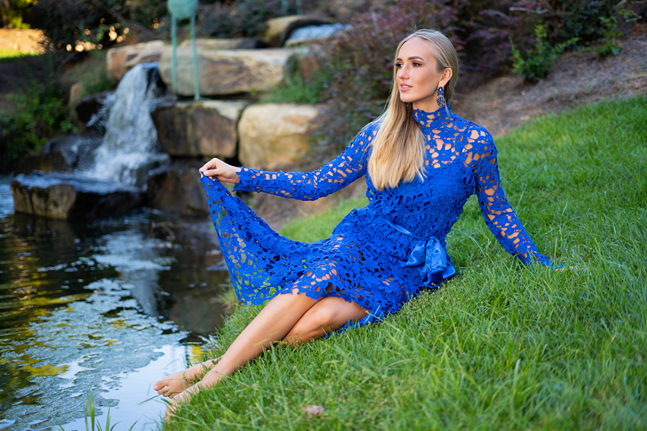 Pictures female Olga Clevenger Blonde girl Grass Stream Dress Sitting Modelling Girls young woman Creek brook Creeks Streams sit gown frock Model