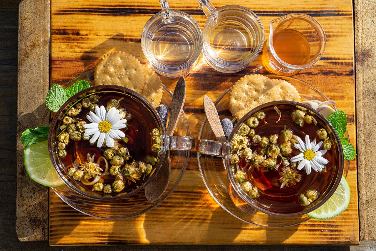 Bilder Tee Limette Kamillen Trinkglas Kekse Tasse das Essen Lebensmittel