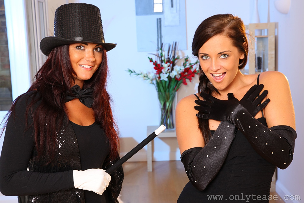 Images Daisy Watts India Reynolds Brown haired Smile Glove 2 Hat female Hands Bow tie Staring Two Girls young woman Glance