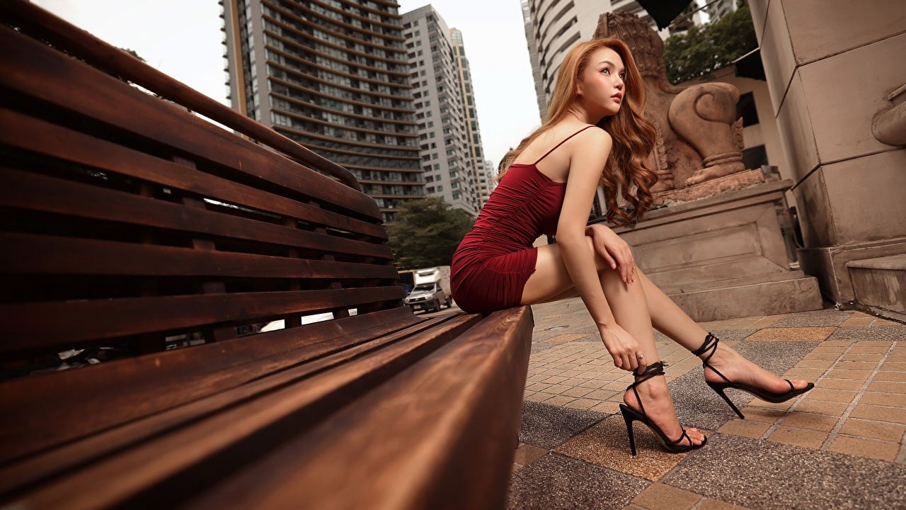 Images Brown haired female Legs Asian sit Bench Hands Dress Stilettos Girls young woman Asiatic Sitting gown frock high heels