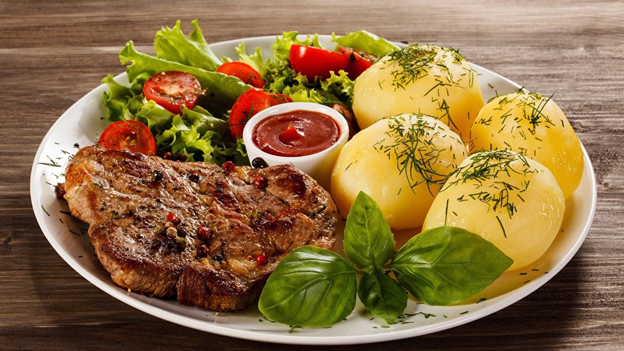Fotos Gebratenes Tomaten Kartoffel Schweinefleisch Dill Ketchup Teller Lebensmittel Gebraten Gebratener Tomate das Essen